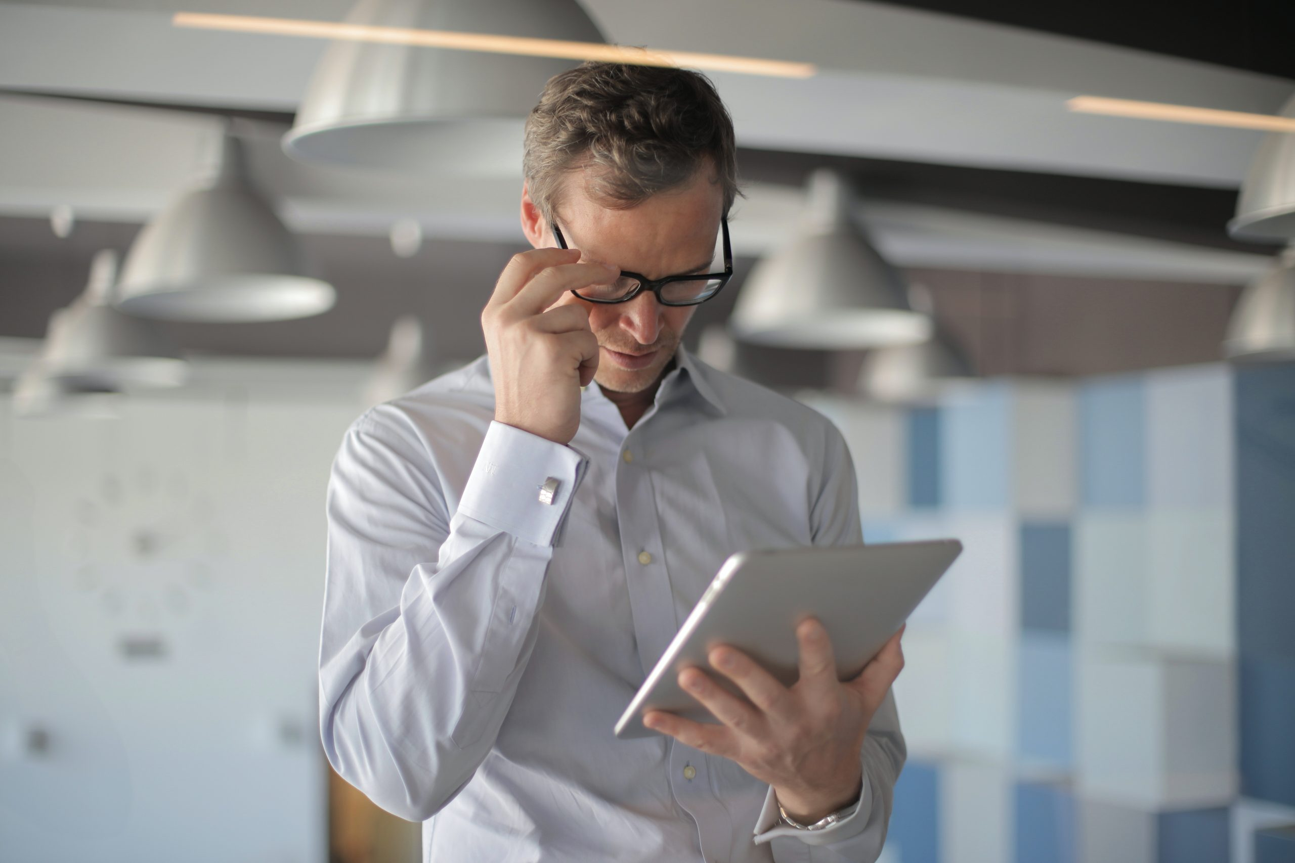 man reading an article on tablet 3760096 scaled